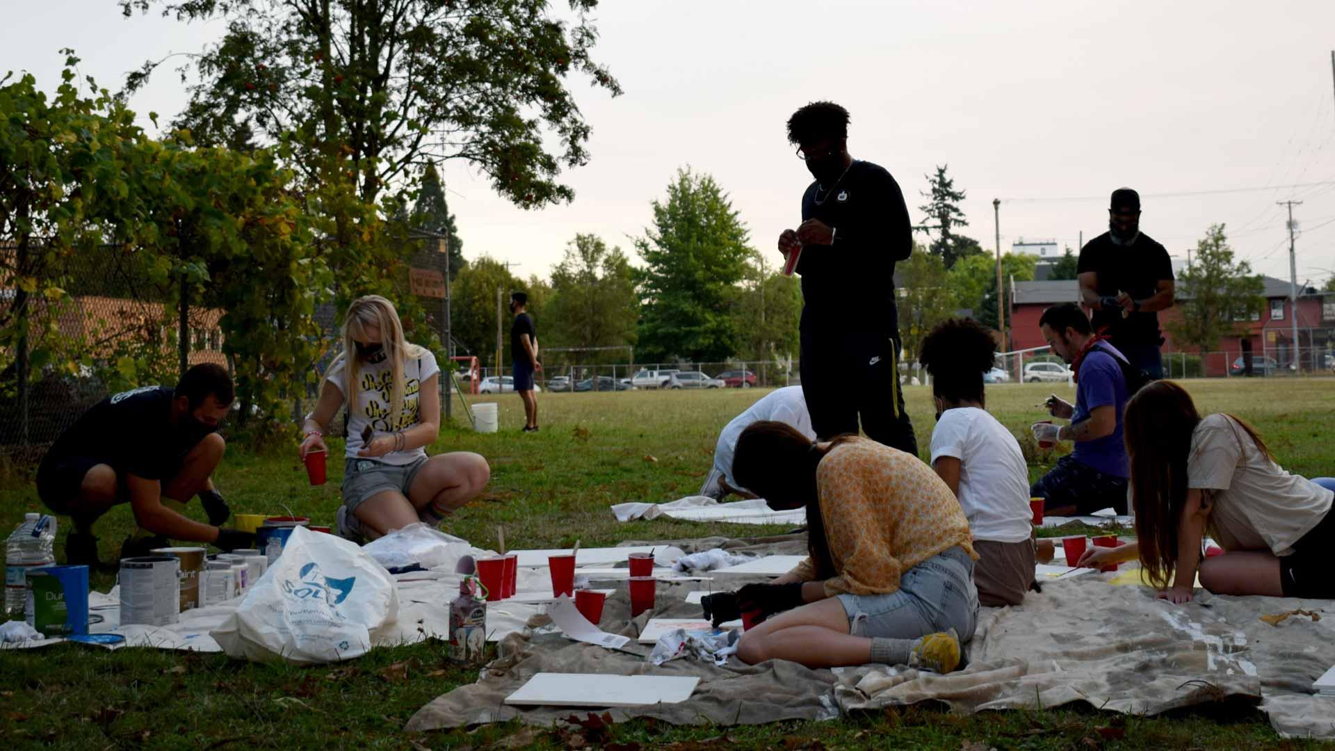 Volunteers create community art
